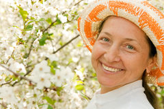 Portrait of beautiful mature woman. Woman aged stands in lush garden stock photos