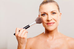 Mature woman makeup Stock Images