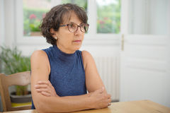 Portrait of a beautiful mature woman with glasses royalty free stock photo