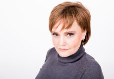Portrait of a beautiful mature woman with short hair Royalty Free Stock Image