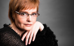 Portrait of a beautiful mature woman with short hair Royalty Free Stock Images