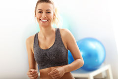 Portrait of beautiful mature woman smiling in health club Stock Images