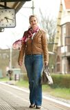 Portrait of a beautiful mature woman standing on train station platform Stock Image