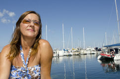 Portrait Beautiful mature woman in yacht harbour Stock Photos