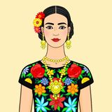 Portrait the beautiful Mexican woman in national clothes. Isolated on a beige background. Stock Photo