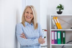 Portrait of beautiful middle aged businesswoman in office stock photography
