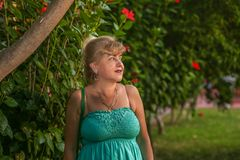 Portrait of a beautiful middle-aged caucasian woman with a beautiful figure and big beautiful breasts in a beautiful summer dress. Portrait of a beautiful middle stock photo