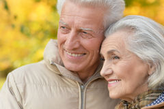 Portrait of a beautiful middle-aged couple in the autumn park Stock Image
