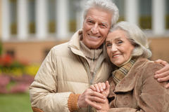 Portrait of a beautiful middle-aged couple in the autumn park Stock Photos