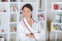 Portrait beautiful middle aged female doctor smiling royalty free stock photo
