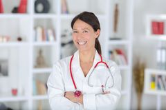 Portrait beautiful middle aged female doctor smiling stock image
