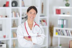 Portrait beautiful middle aged female doctor smiling Stock Images