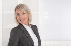Portrait: Beautiful middle aged isolated businesswoman. royalty free stock photos