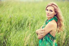 Portrait of a beautiful middle aged blonde woman in field. Outdoor portrait of a beautiful middle aged blonde woman in field royalty free stock images