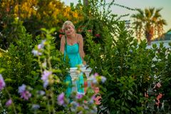 Portrait of a beautiful middle-aged Beautiful mature woman. Beautiful middle-aged woman with a beautiful figure and big breasts in a beautiful summer dress royalty free stock photography