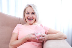 Portrait beautiful middle aged woman drinking water in the morning. Woman's face close up Stock Photography
