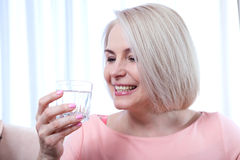 Portrait beautiful middle aged woman drinking water in the morning Royalty Free Stock Image