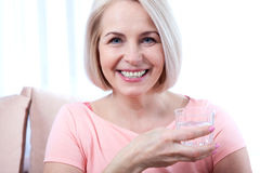 Portrait beautiful middle aged woman drinking water in the morning Royalty Free Stock Images