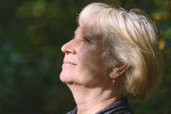 Portrait of a beautiful middle-aged woman outdoors. Royalty Free Stock Photos