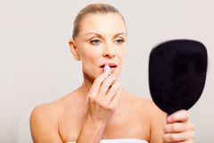 Middle aged woman lipstick Royalty Free Stock Photography