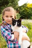 Mixed Breed Of Cat In Child Hands Embrace Of Little Russian Girl stock photos