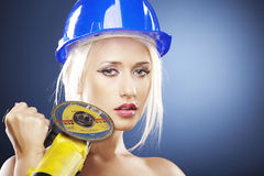 Portrait of a beautiful model with angle grinder Royalty Free Stock Image