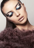 Portrait of beautiful model with bright eyes makeup Stock Images