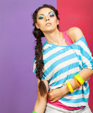 Portrait of a beautiful model with creative dynamic multicolor m Stock Image