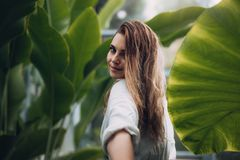 Portrait of beautiful model in greenhouse Royalty Free Stock Photos