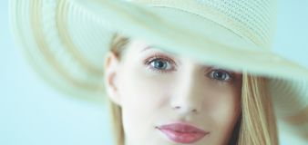Portrait of beautiful model in hat ,isolated on white background stock image