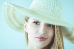 Portrait of beautiful model in hat ,isolated on white background stock photography