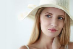 Portrait of beautiful model in hat ,isolated on Royalty Free Stock Photo