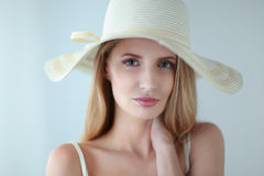 Portrait of beautiful model in hat , on white background Royalty Free Stock Photography