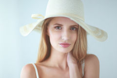 Portrait of beautiful model in hat , on white background Stock Photography
