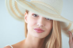 Portrait of beautiful model in hat , on white background Royalty Free Stock Photo