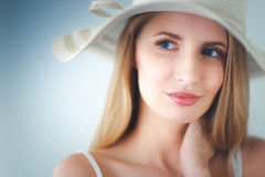 Portrait of beautiful model in hat , on white background Stock Image
