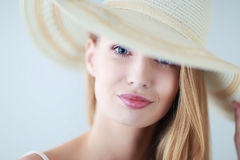 Portrait of beautiful model in hat , on white background Stock Photo
