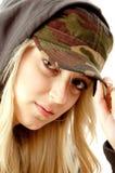 Portrait of beautiful model holding cap Stock Photos