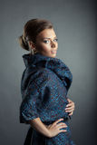 Portrait of beautiful model posing in stylish coat. Close-up Royalty Free Stock Photos
