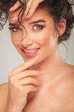 Portrait of beautiful model touching face and fixing hair Royalty Free Stock Photography