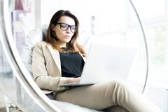 Modern Businesswoman Resting in Office stock image