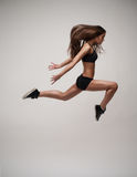 Beautiful modern dancer jumping Stock Photo