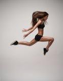Beautiful modern dancer jumping Stock Photo