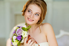 Portrait of beautiful modest shy and very cute girl with brown h Stock Photos