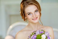 Portrait of beautiful modest shy and very cute girl with brown h Stock Image