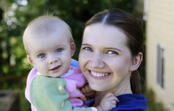 Portrait of Beautiful Mother And Baby with blue eyes Royalty Free Stock Images