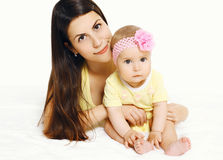 Portrait of beautiful mother and cute baby lying Stock Photography