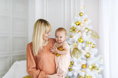 Portrait of beautiful mother and dauther near the Christmas tree Stock Photography