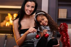 Portrait of beautiful mother and ethnic daughter. Portrait of beautiful white mother and cute ethnic daughter at christmas time stock photos