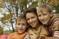 Portrait of a beautiful mother and her children Stock Photos